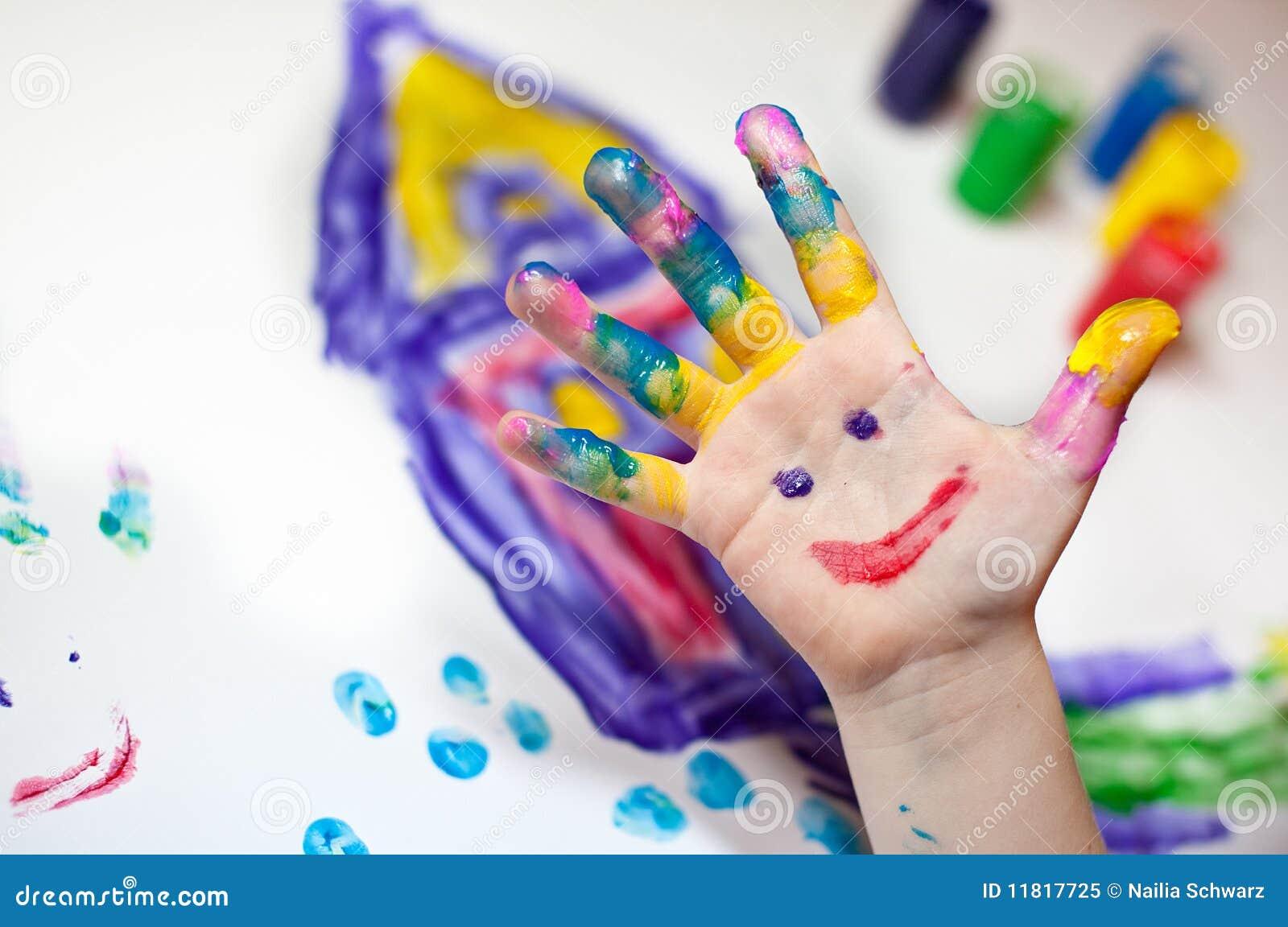 Children Hands doing Fingerpainting