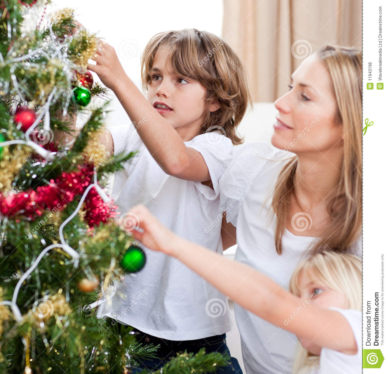 Children hanging Christmas decorations