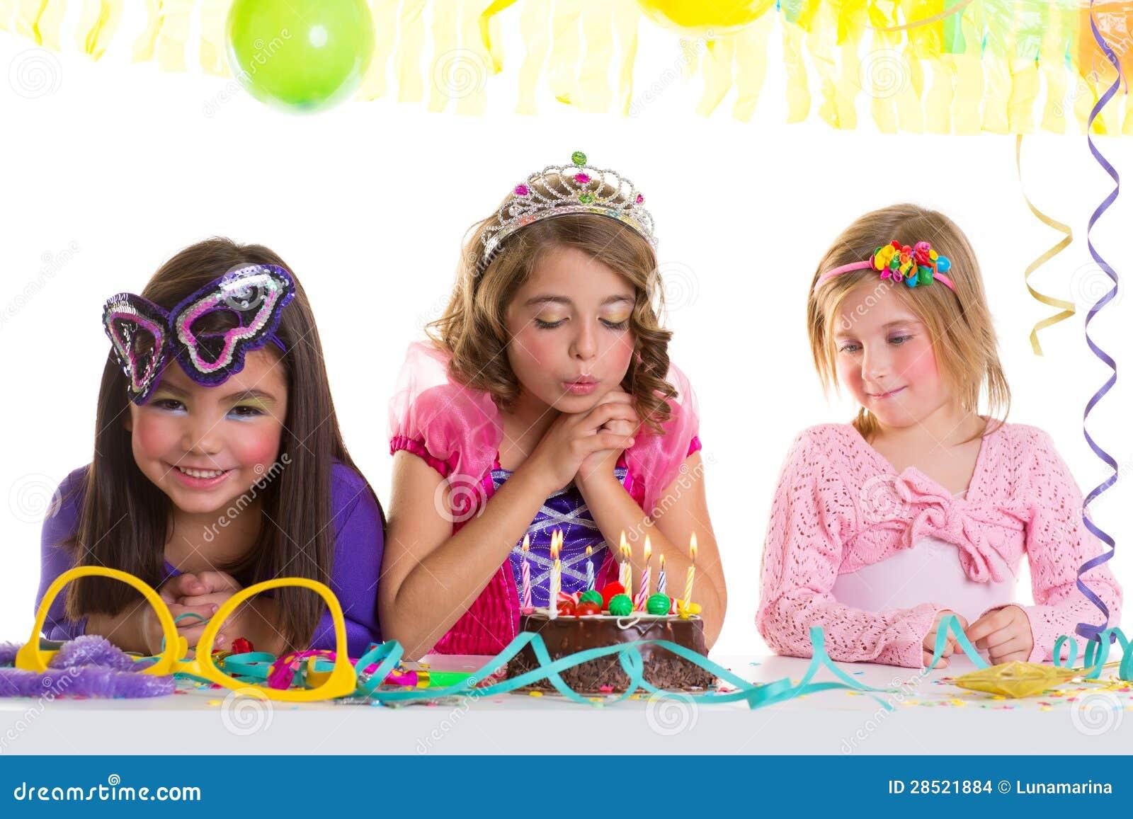 Children Happy Girls Blowing Birthday Party Cake Stock
