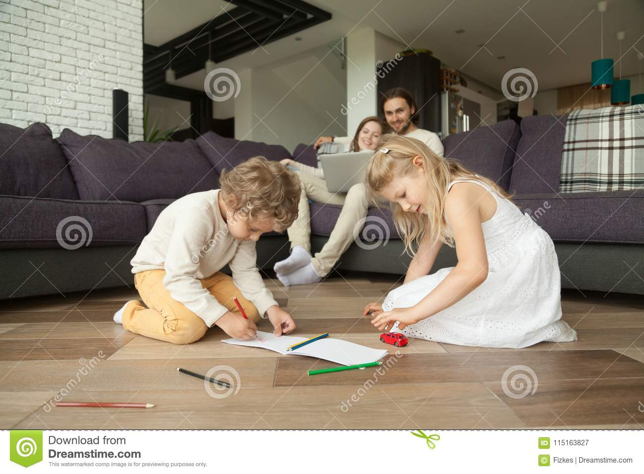 Children having fun drawing together, happy family leisure home