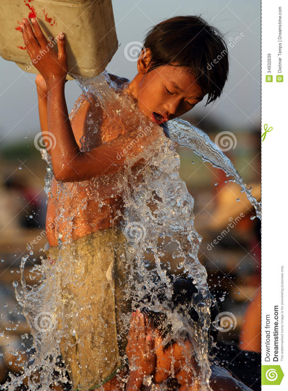 Children in shower Children having fun in Mandalay Editorial Stock Image