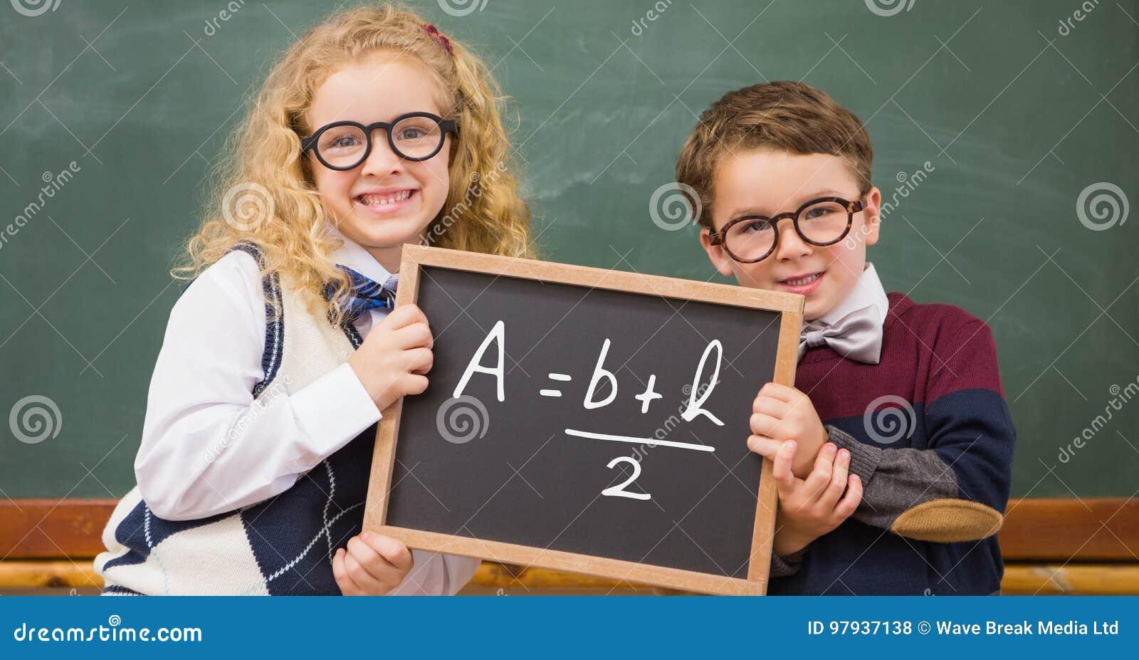 Children holding blackboard with math equation