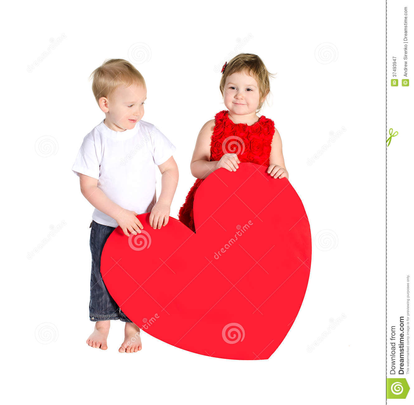 Children with huge heart made of red paper