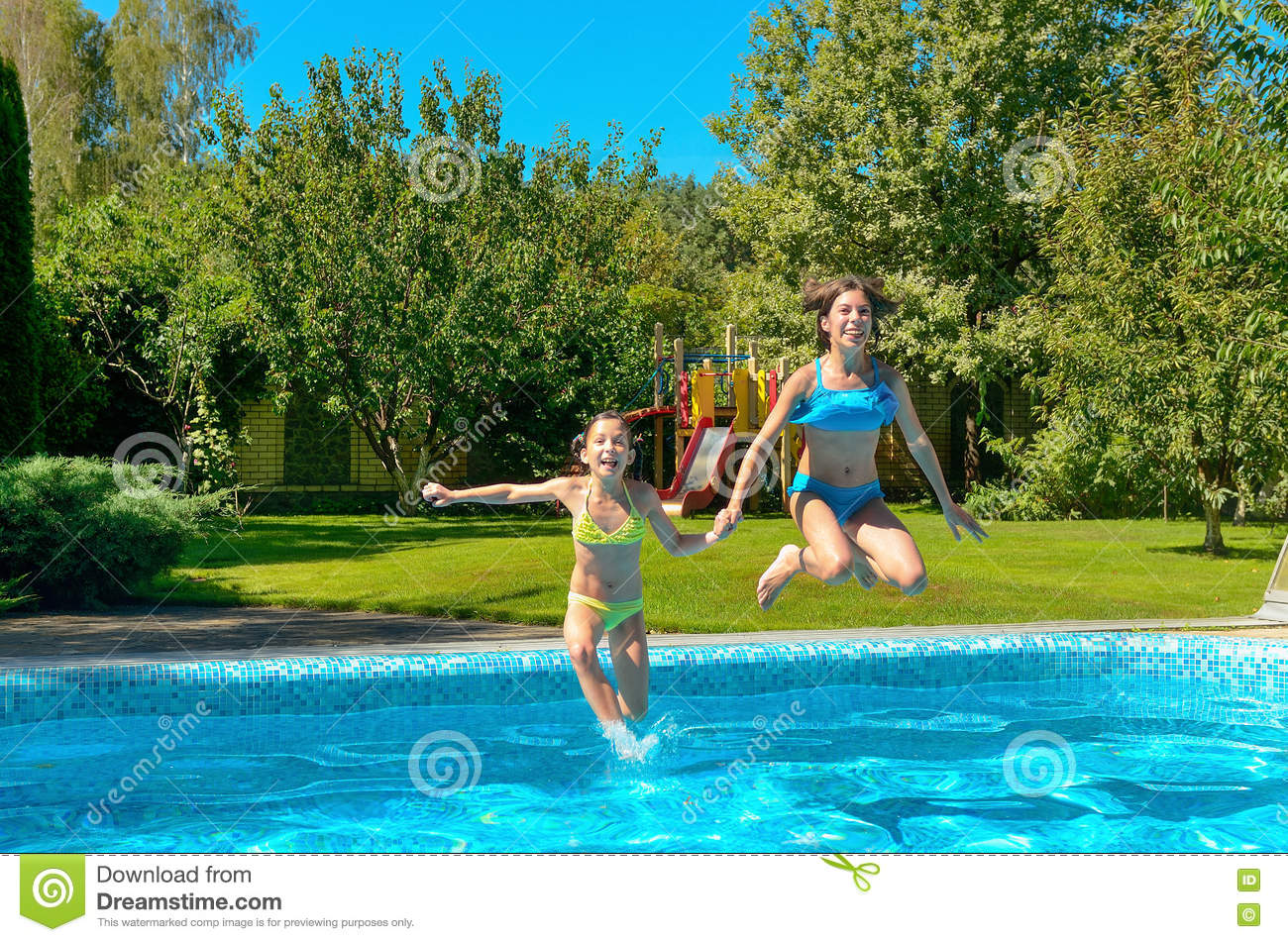 Children jump to swimming pool water and have fun kids on for Family swimming pool