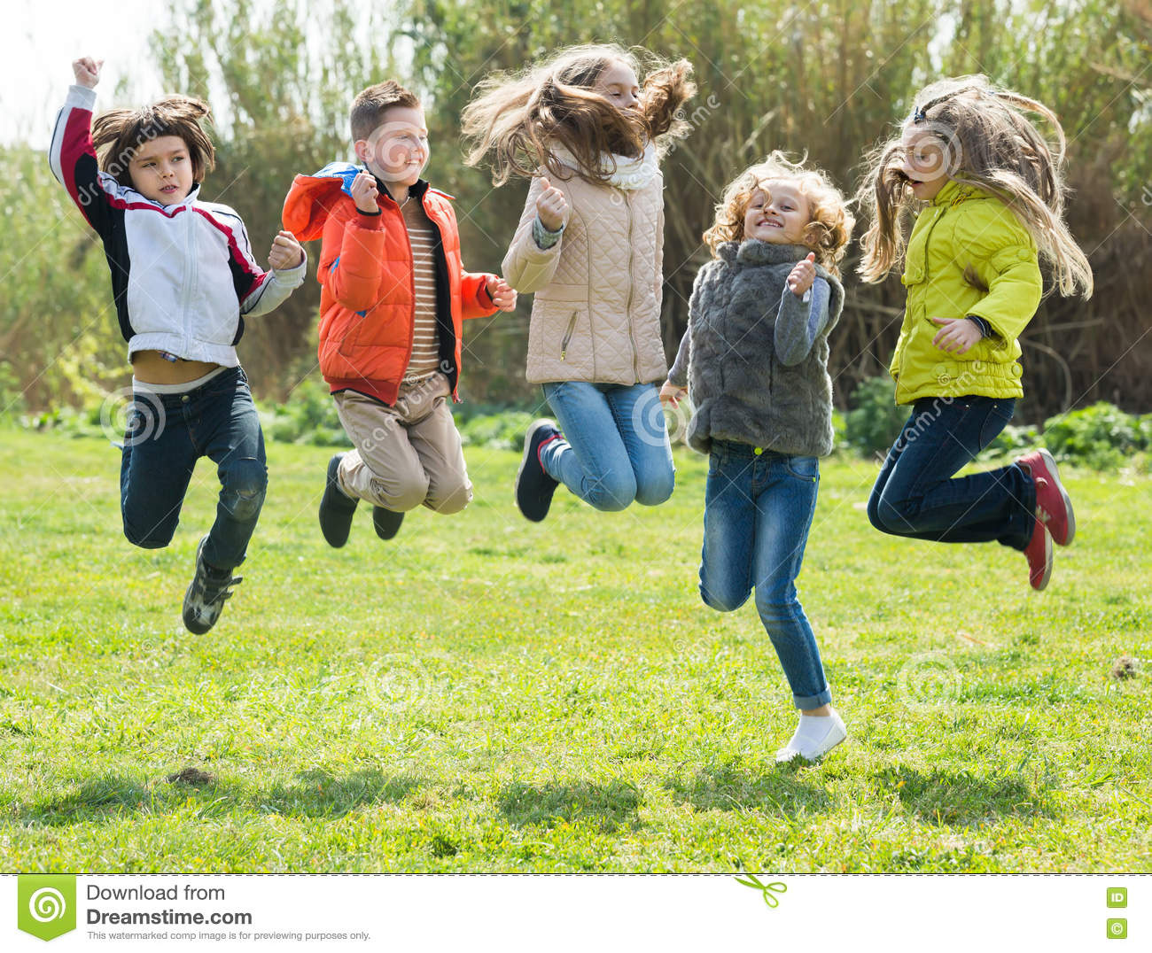c9398fca1f39d Children jumping outdoors stock photo. Image of person ... Stock Vector  Cartoon Illustration Group Happy ...