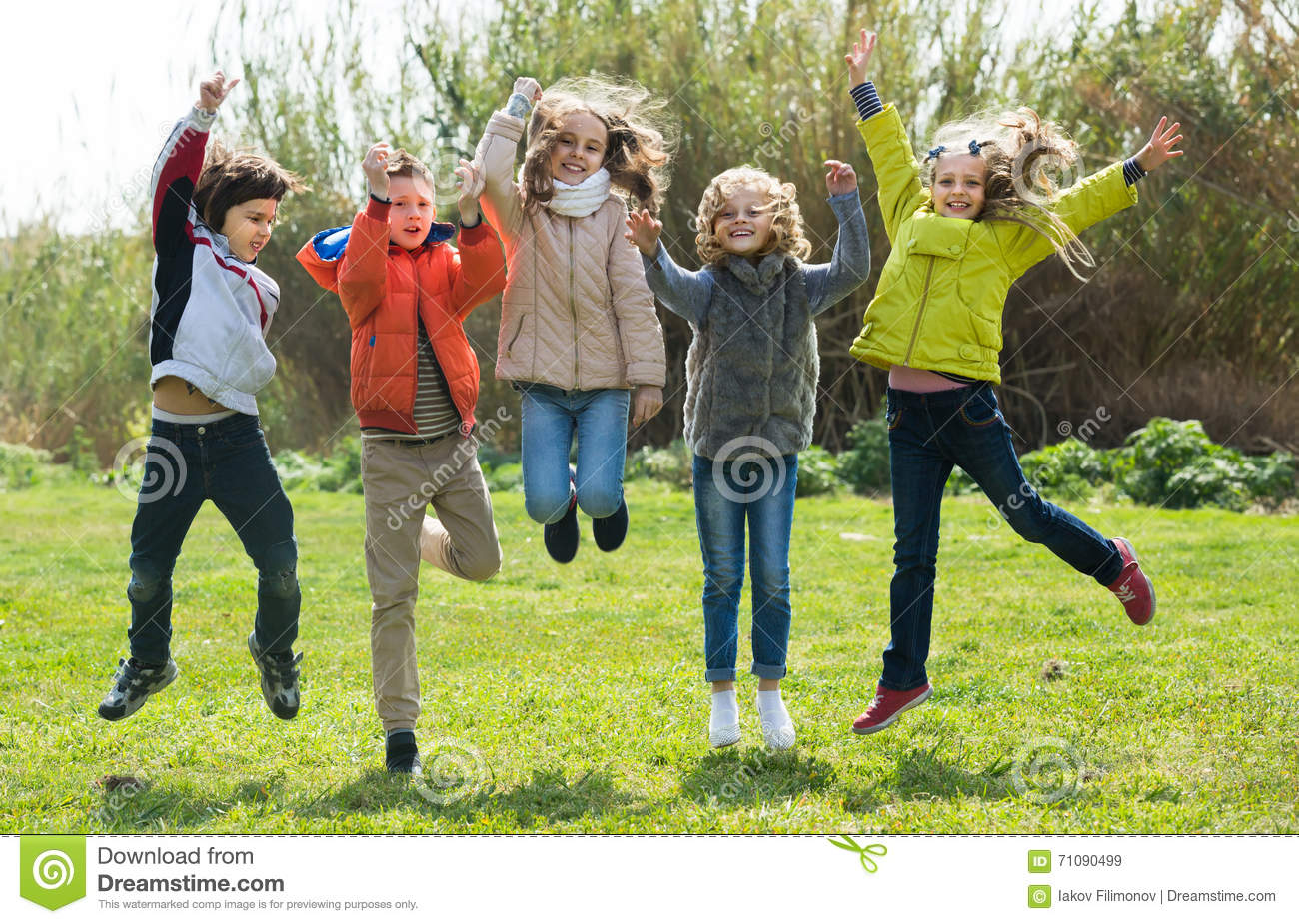 Children Jumping Outdoors Stock Image