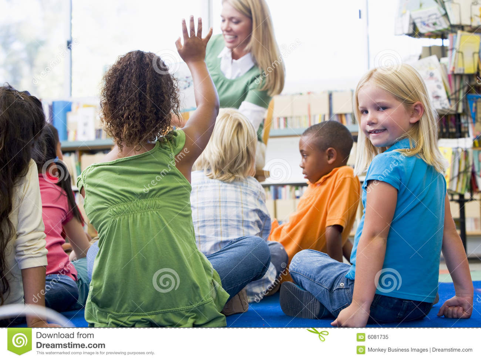 Children kindergarten reading teacher to