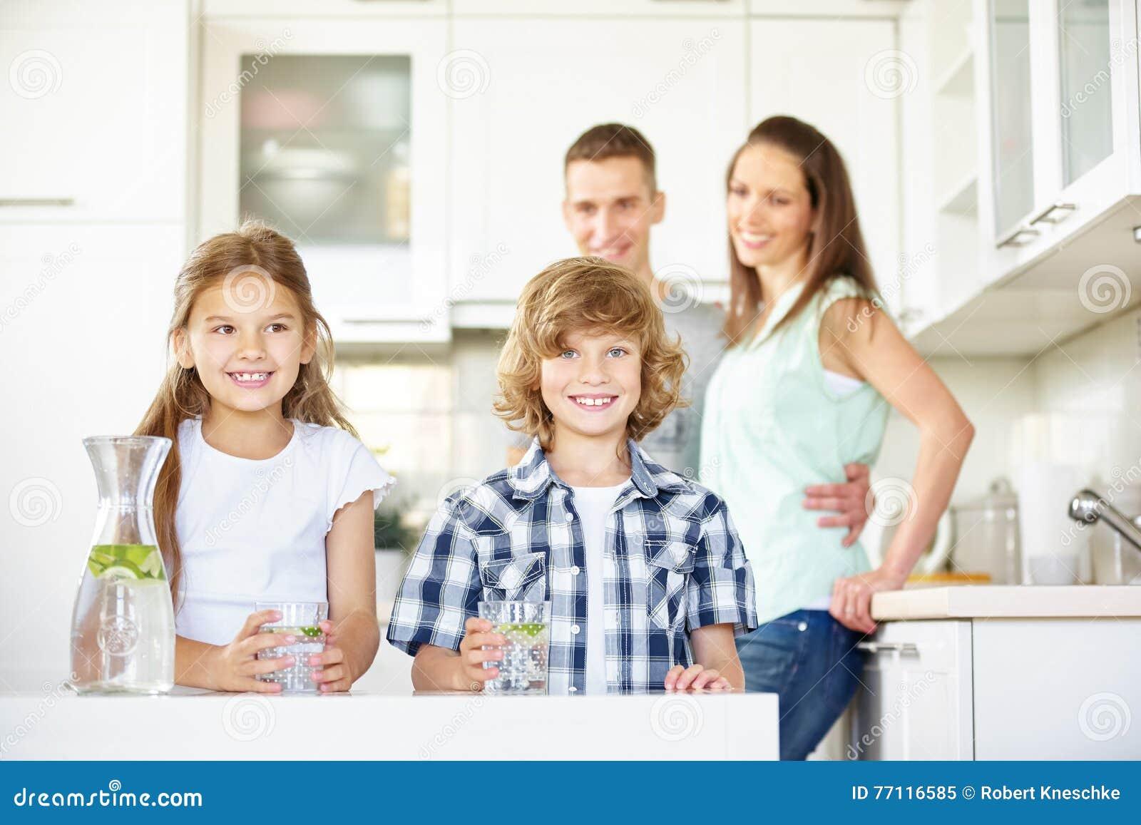 Children in kitchen with fresh water