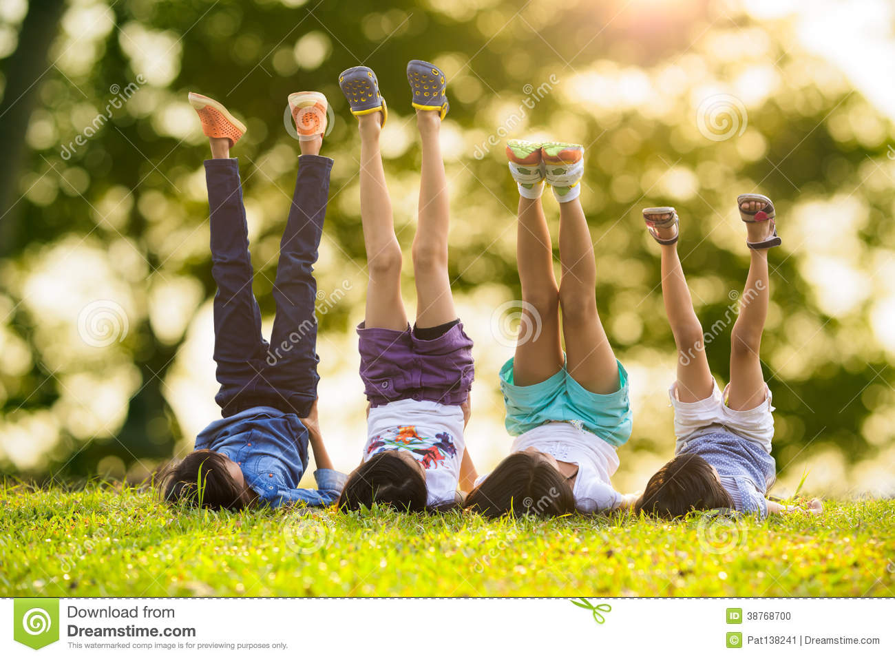 Children laying on grass