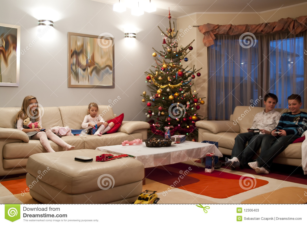 four children boys and girls sitting in the living room watching