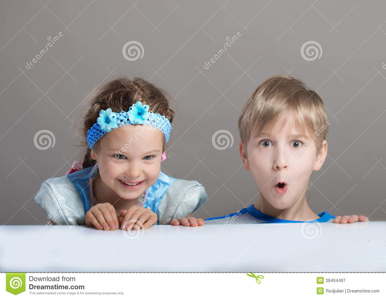 Children Looking At Camera From Behind The Table Stock ... Positive Space Photography
