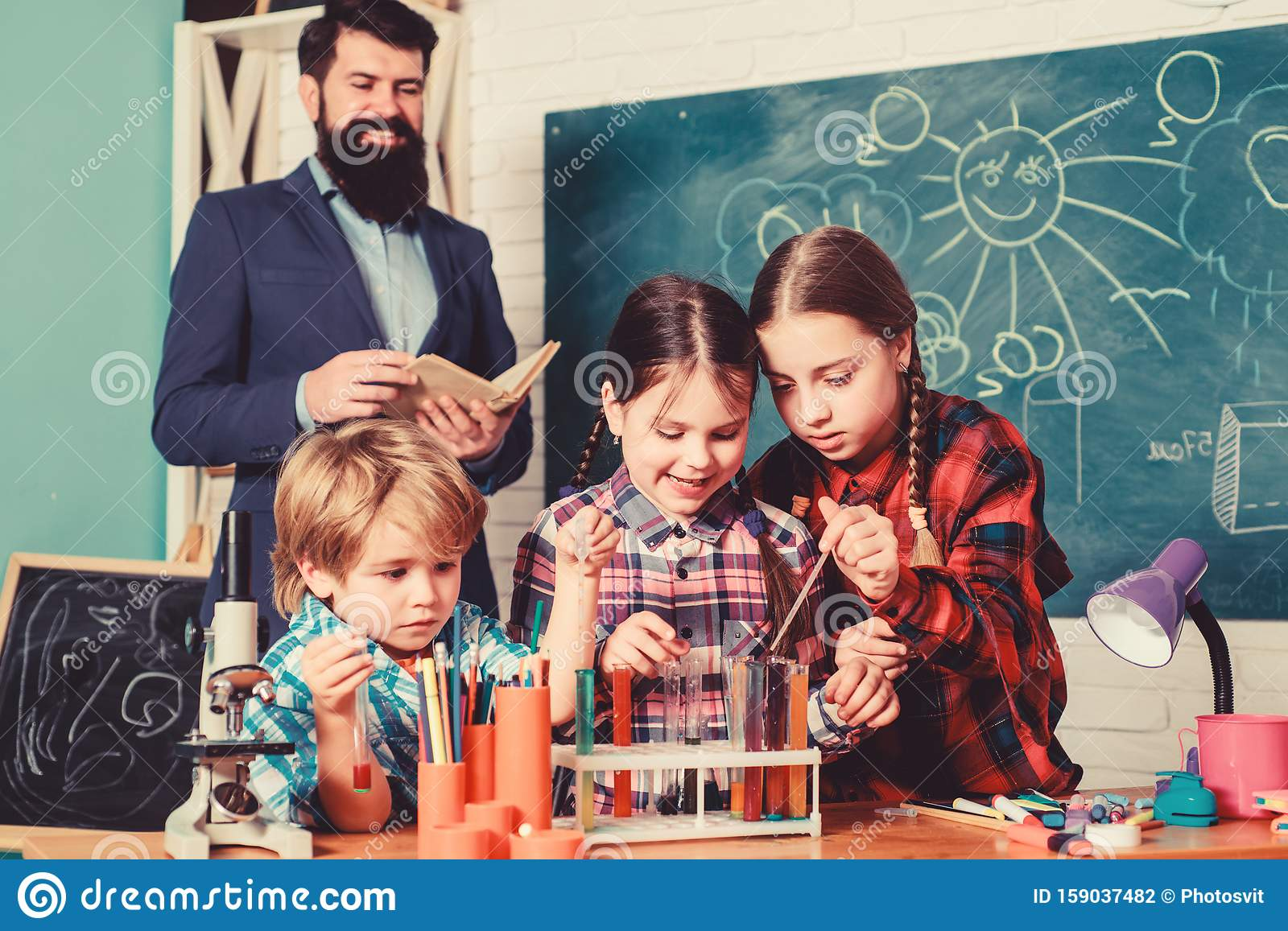 Children making science experiments. Education. Science and education. chemistry lab. happy children teacher. back to