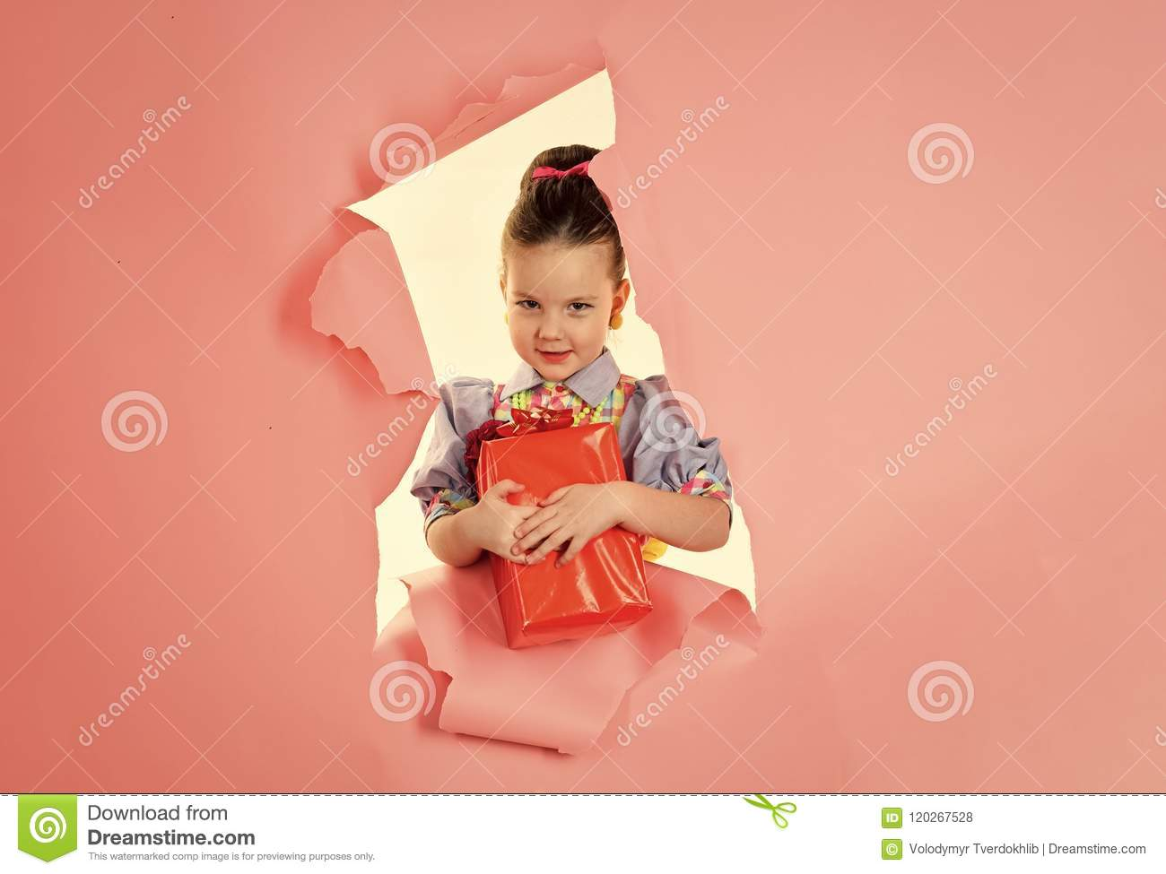 Children model. Small girl with shopping package, black friday. Birthday and christmas. Childhood and happiness, gift