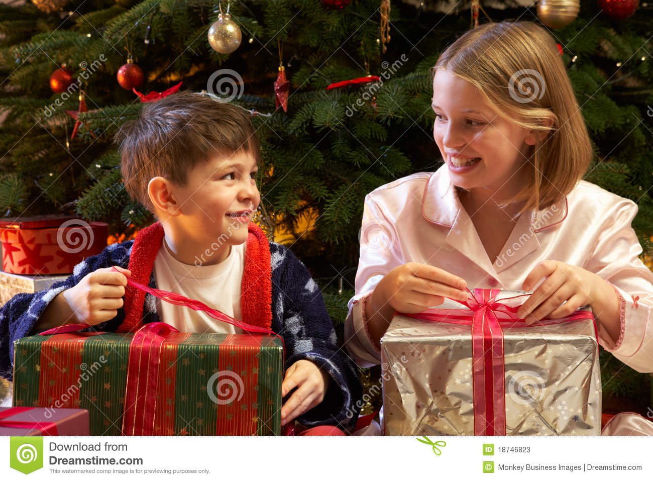 Children Opening Christmas Presents Stock Photo - Image: 73348691