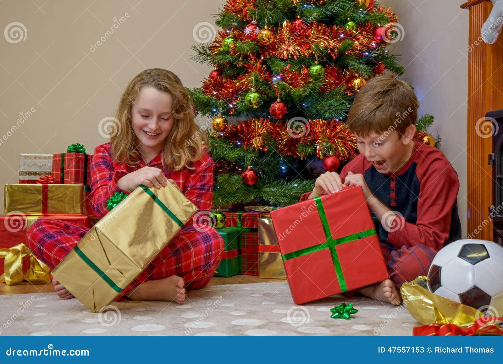 children opening christmas presents