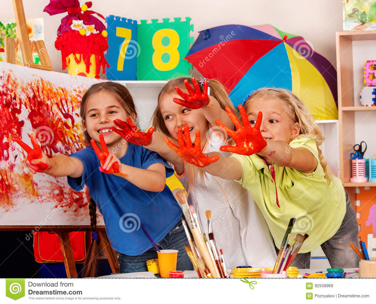 Children Painting Finger On Easel Small Students In Art School