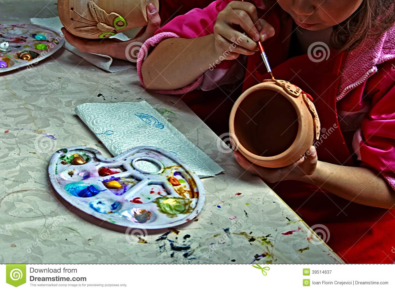 Children painting pottery 2