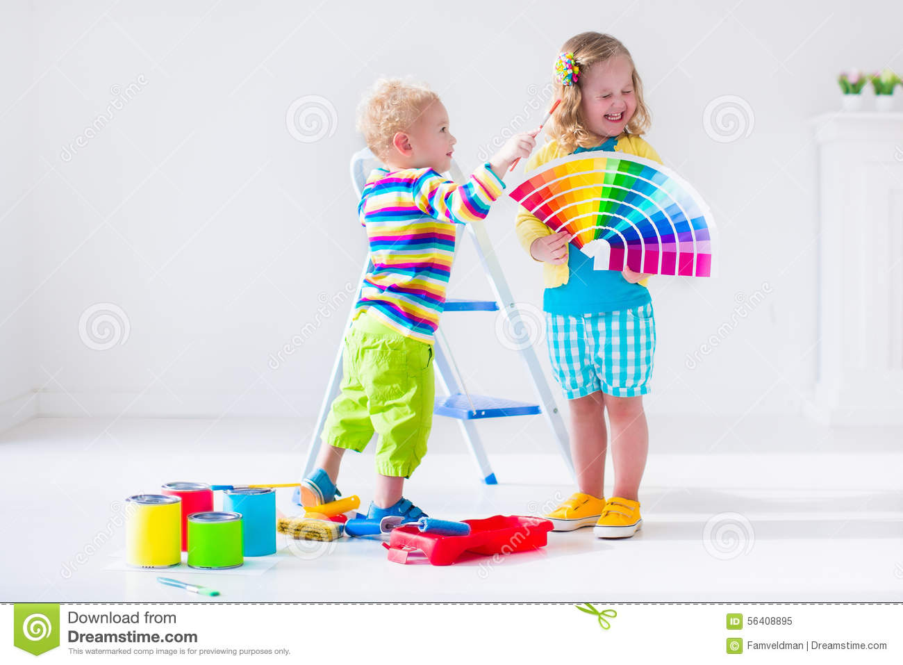Children Painting Walls At Home Remodel Stock Photo