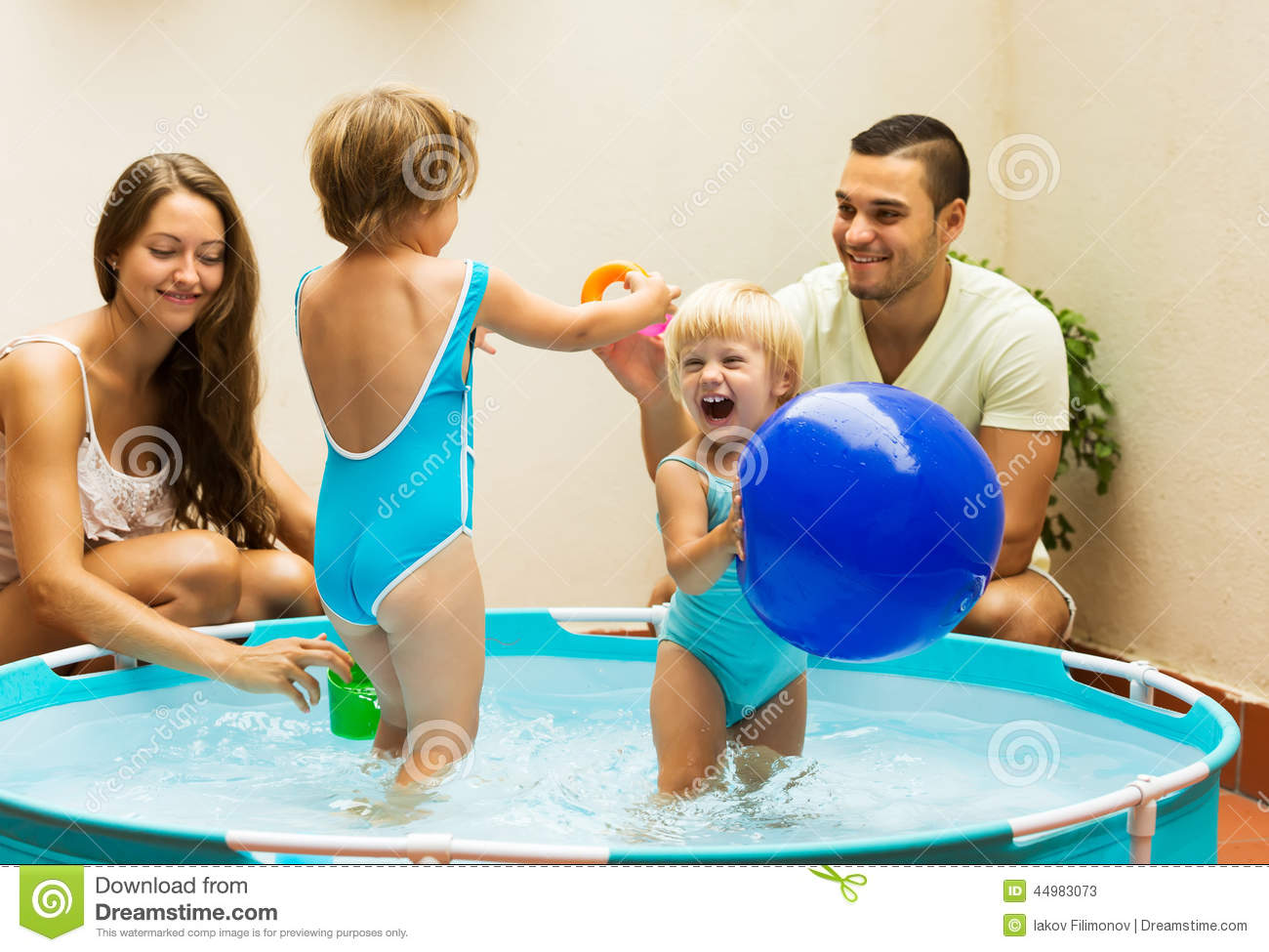Children and parents playing in pool stock photo image for Kids on the terrace