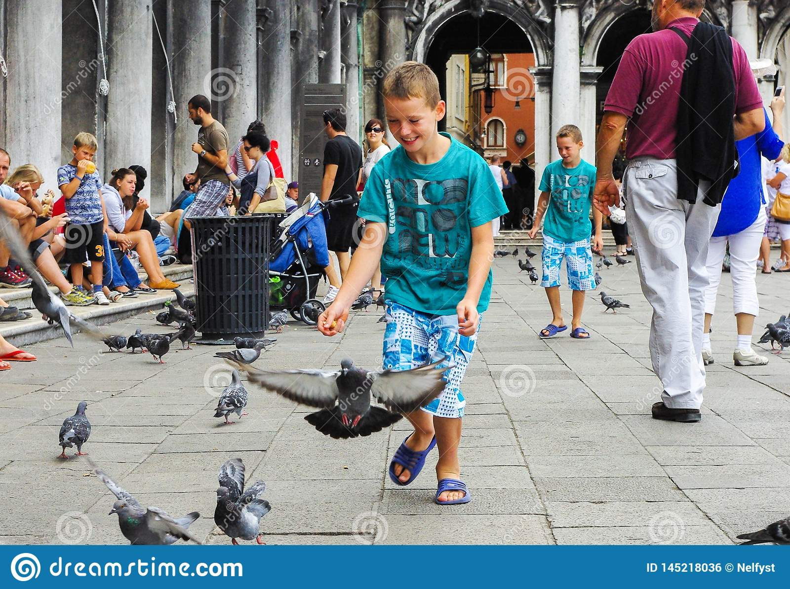 Children and pigeons in Venice