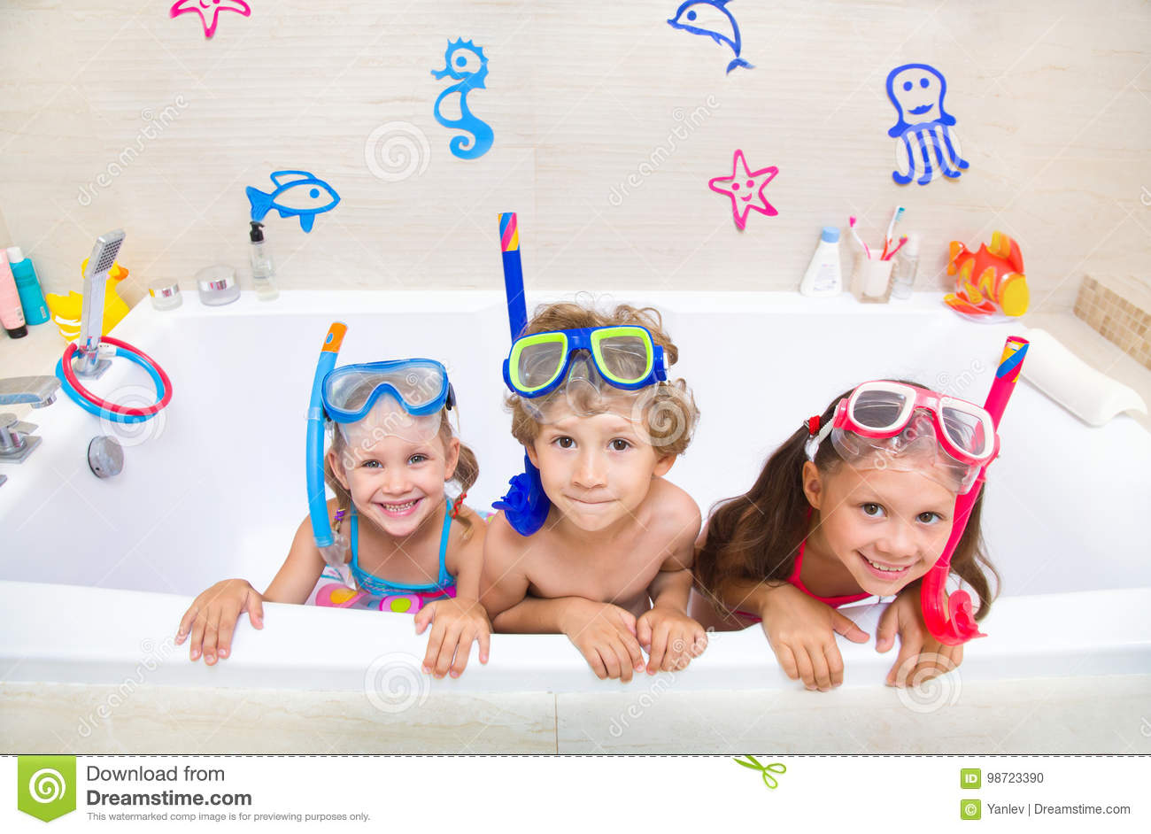 552b0d9a80d8b Little children in swimsuits play in the bathroom like in the sea