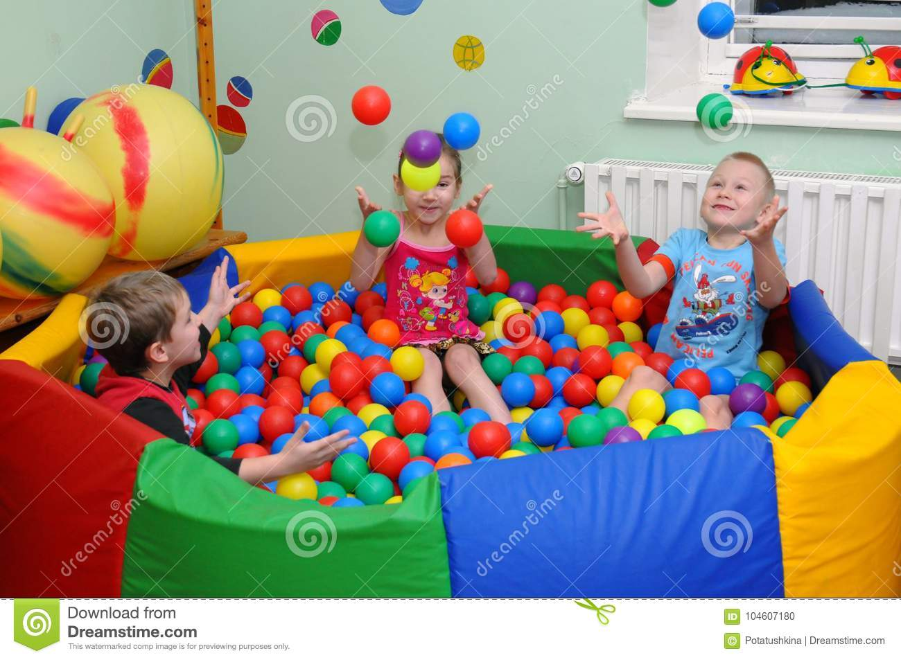 Children play in the `dry` pool