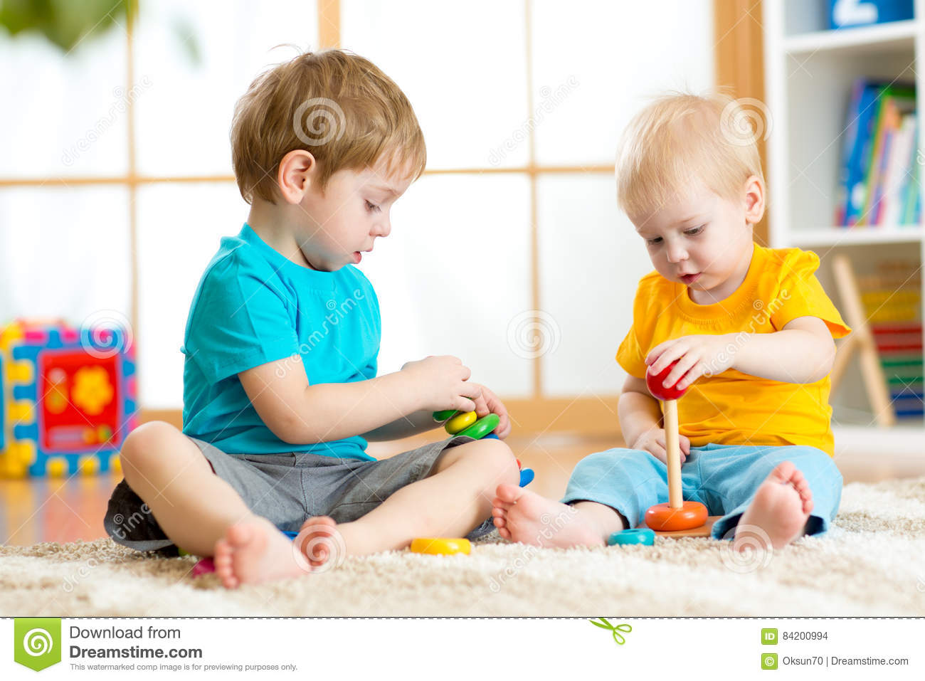 Day Care Toys For Toddler : Children play with educational toys in preschool or