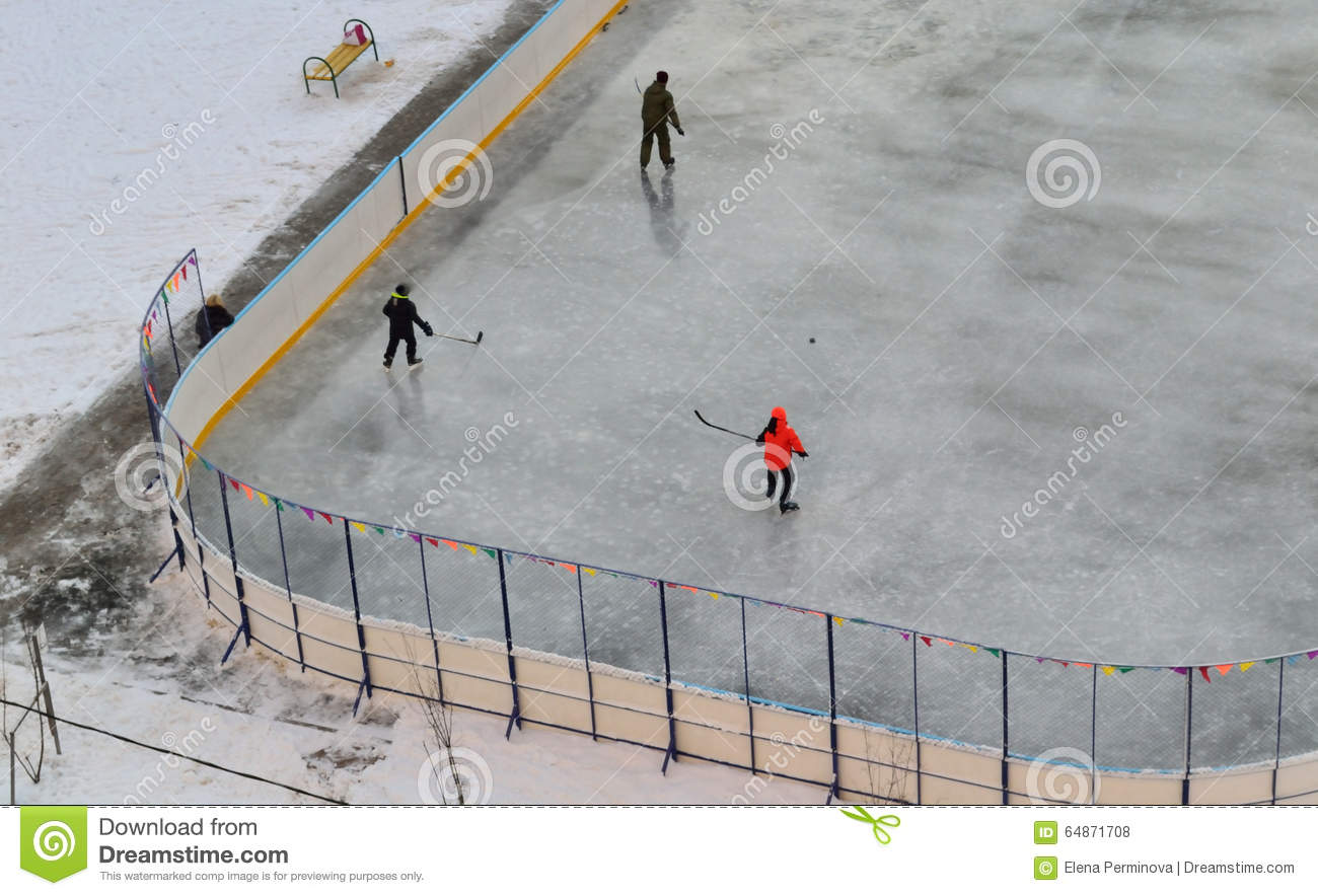 Children play hockey in winter