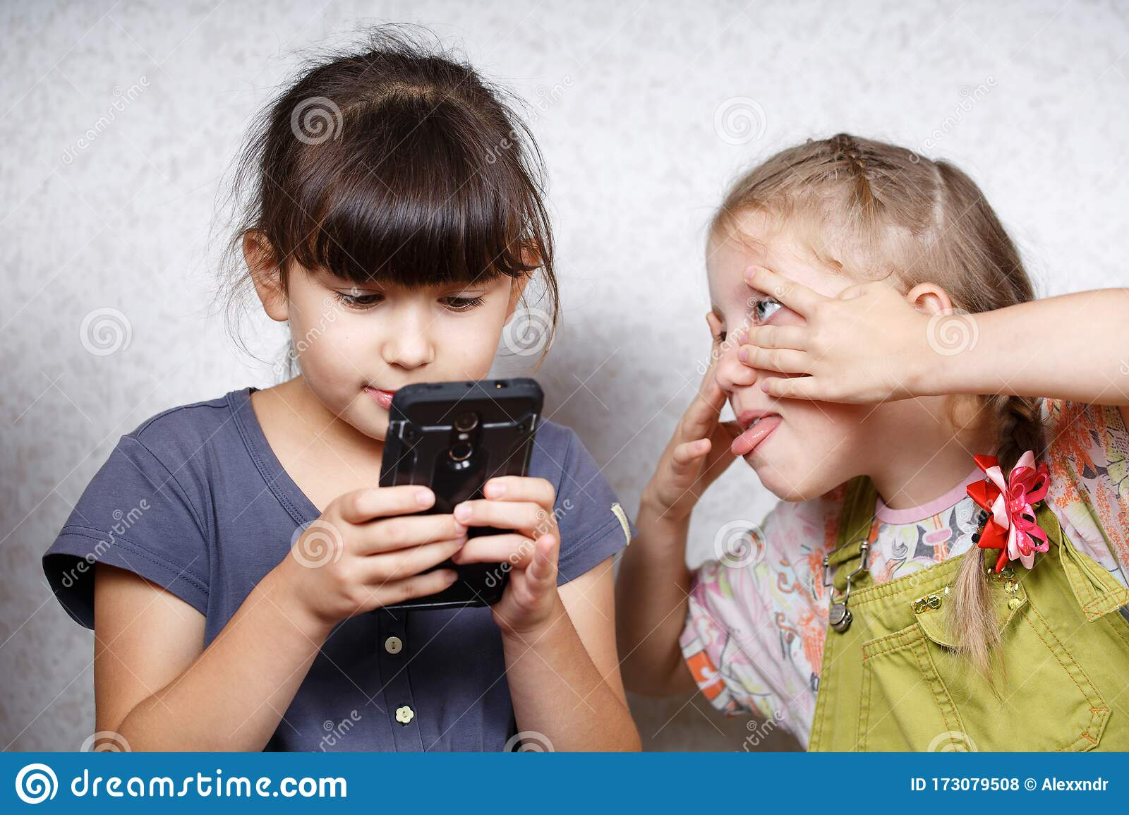 Children Play On The Mobile Phone In Games Stock Photo Image Of Lying Digital 173079508