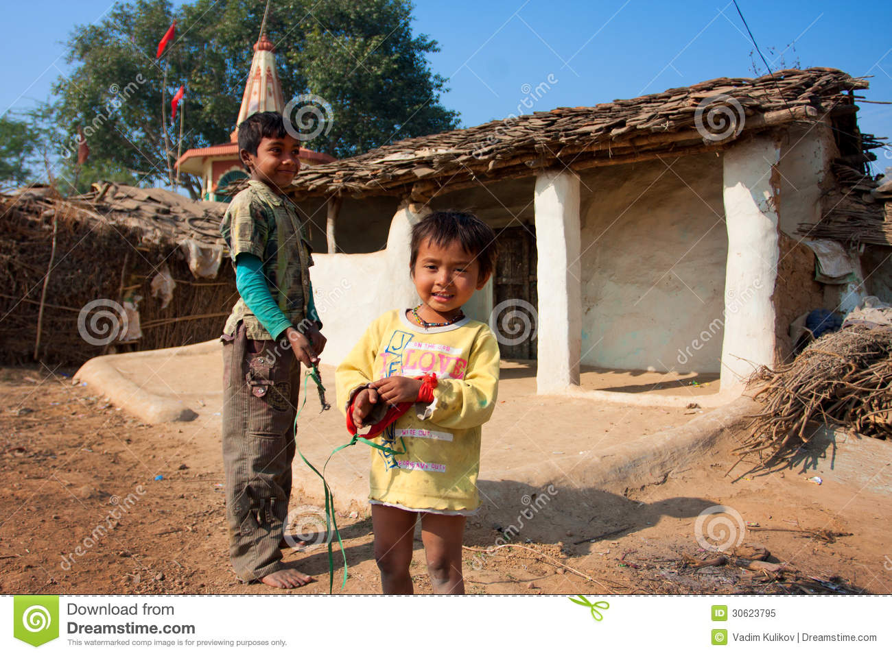 Children Play Near The Mud Village Houses Editorial Image