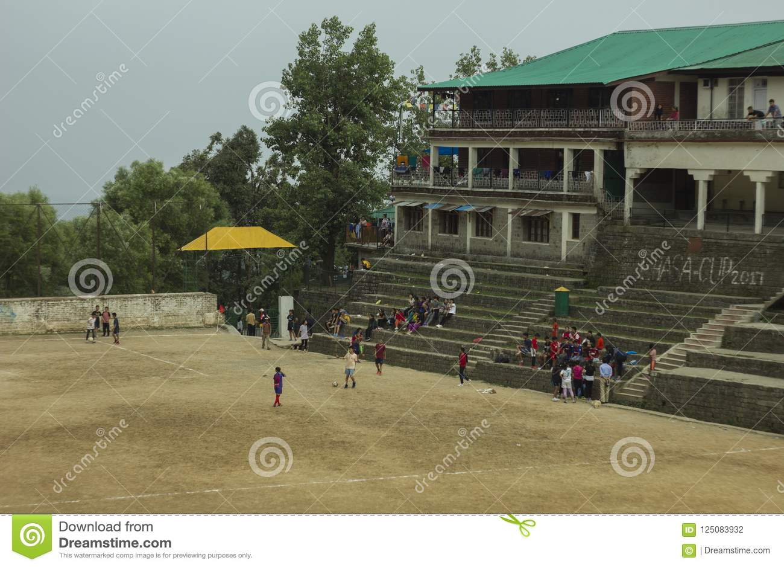 Children play on stadium for sports
