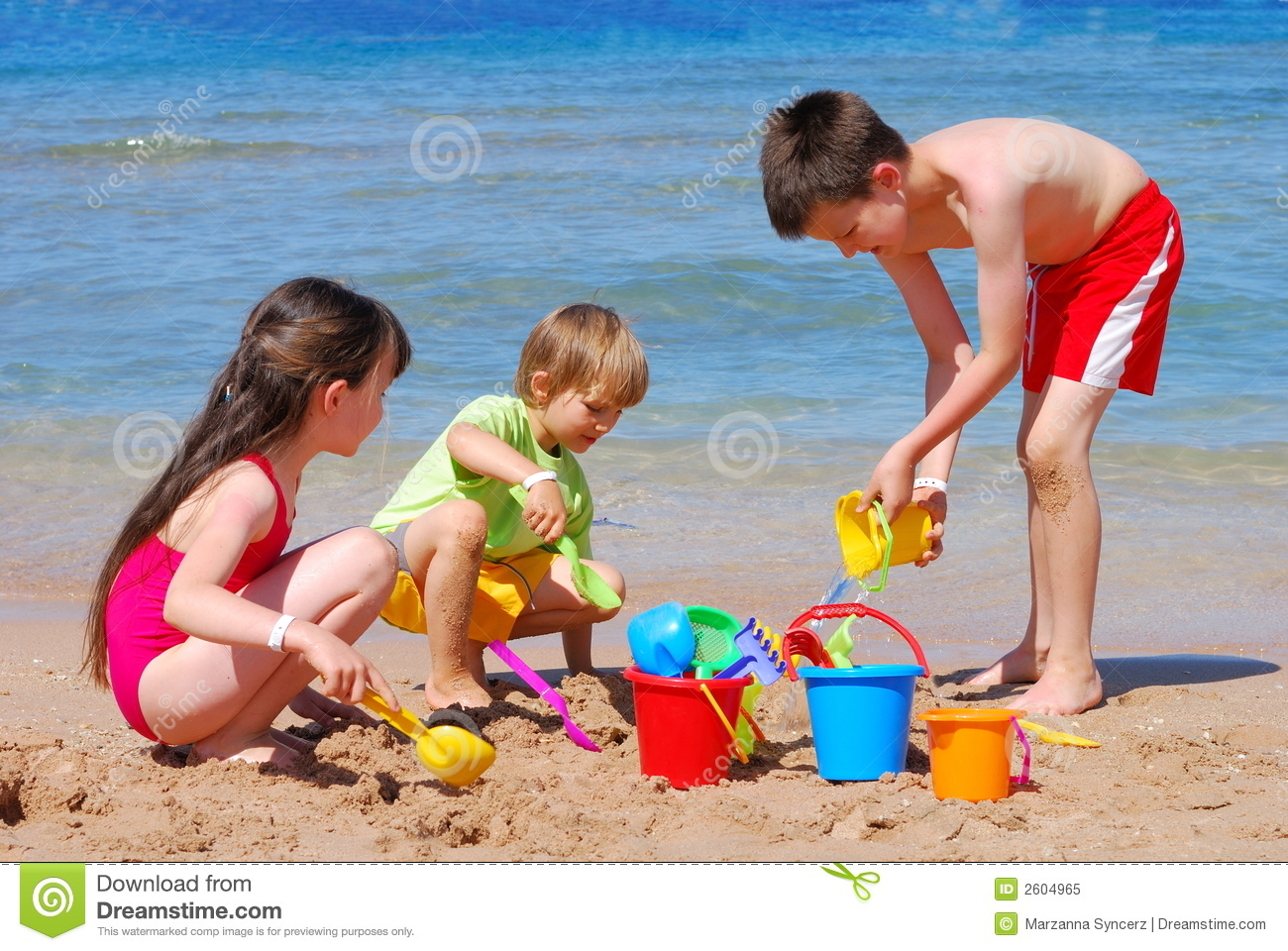 Three children playing in the sand at the beach Kids Playing On The Beach Clipart