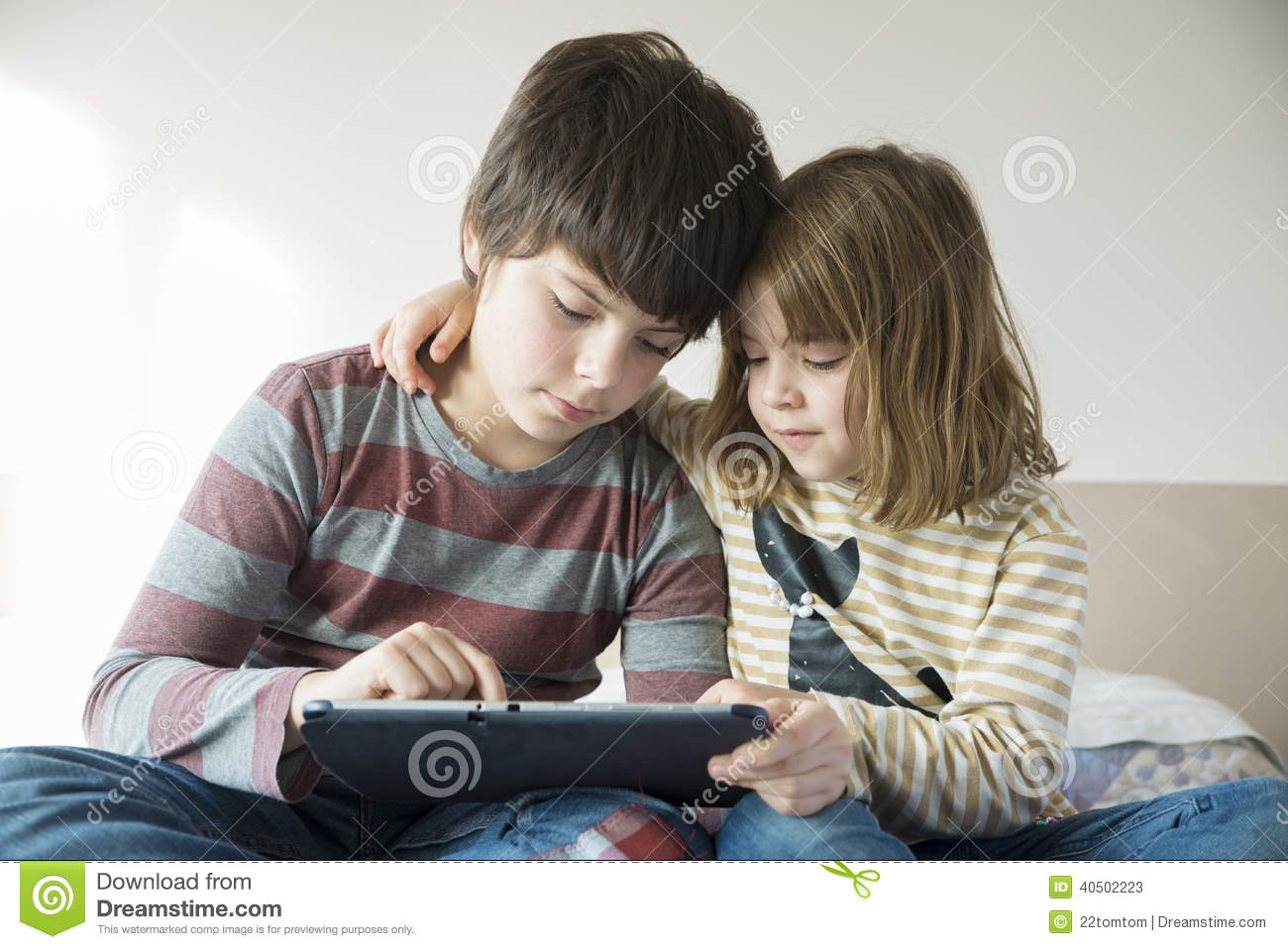 Children playing with a digital tablet