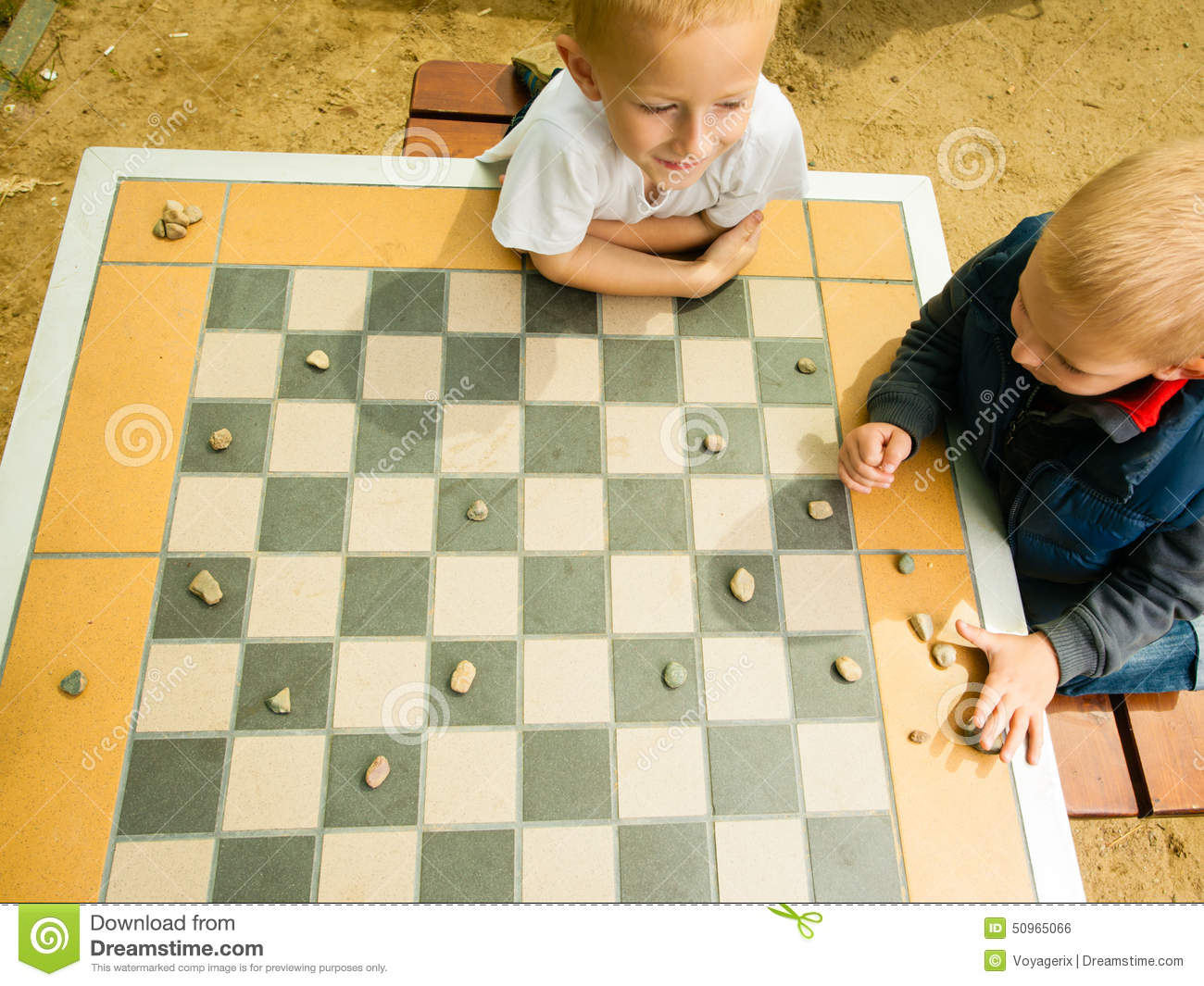 Children Playing Draughts Or Checkers Board Game Outdoor ...