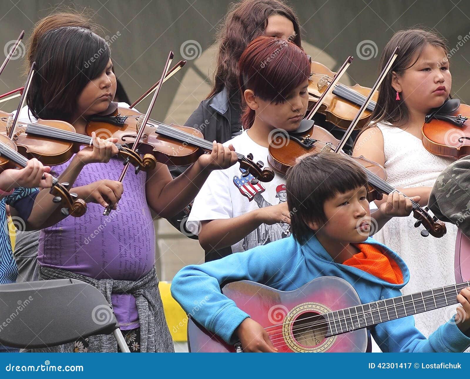 children playing fiddles and guitars editorial photography image of edmonton dancer 42301417. Black Bedroom Furniture Sets. Home Design Ideas