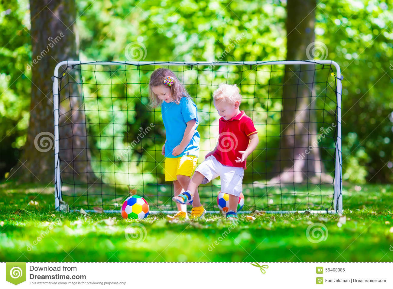 Children playing football outdoors stock photo image for Childrens play yard