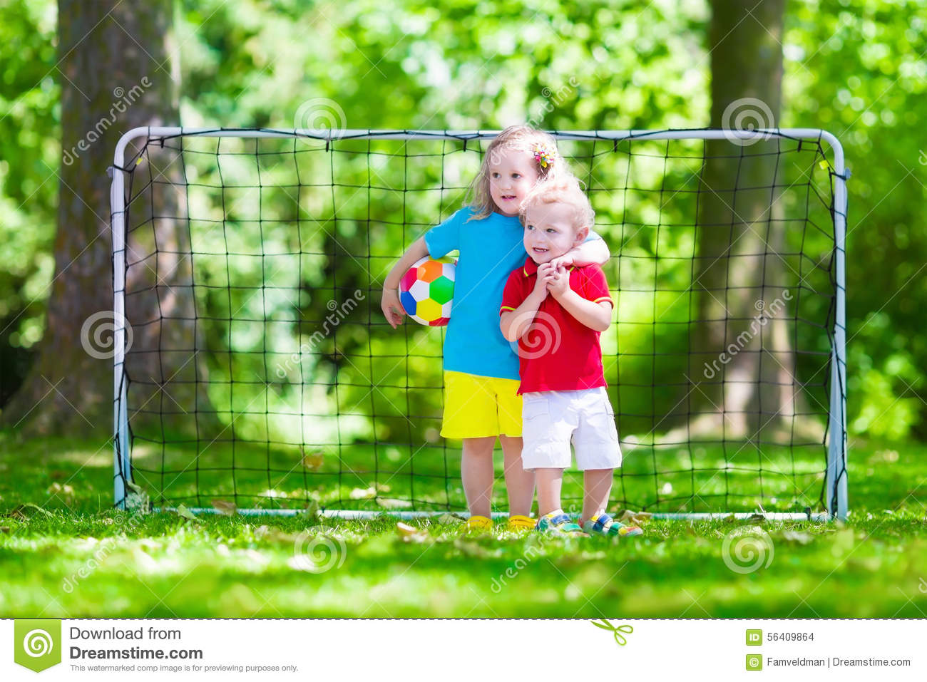 Children Playing Football Outdoors Stock Photo - Image ...