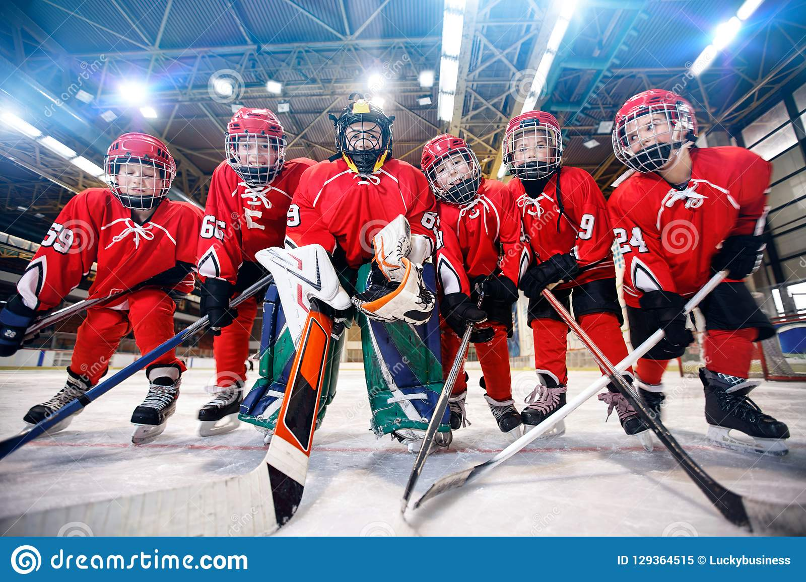 Children playing ice hockey on the rink