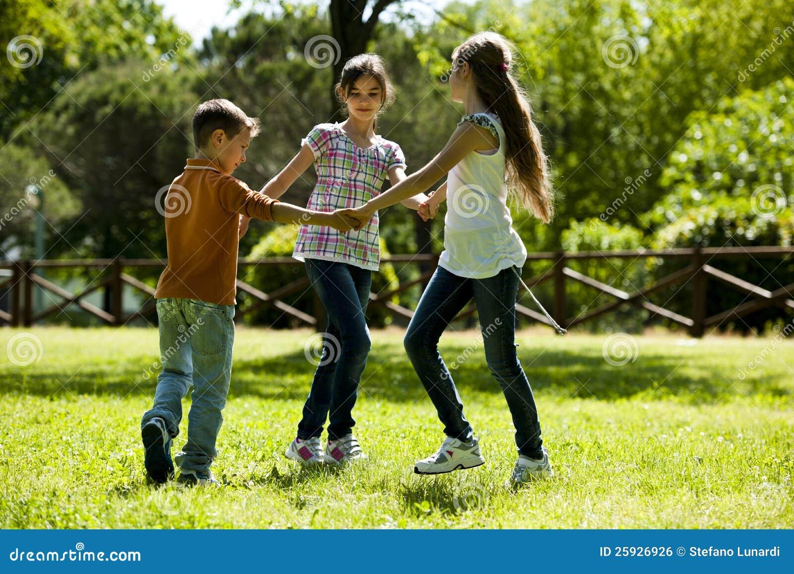 Kids Playing Ring Around The Rosie