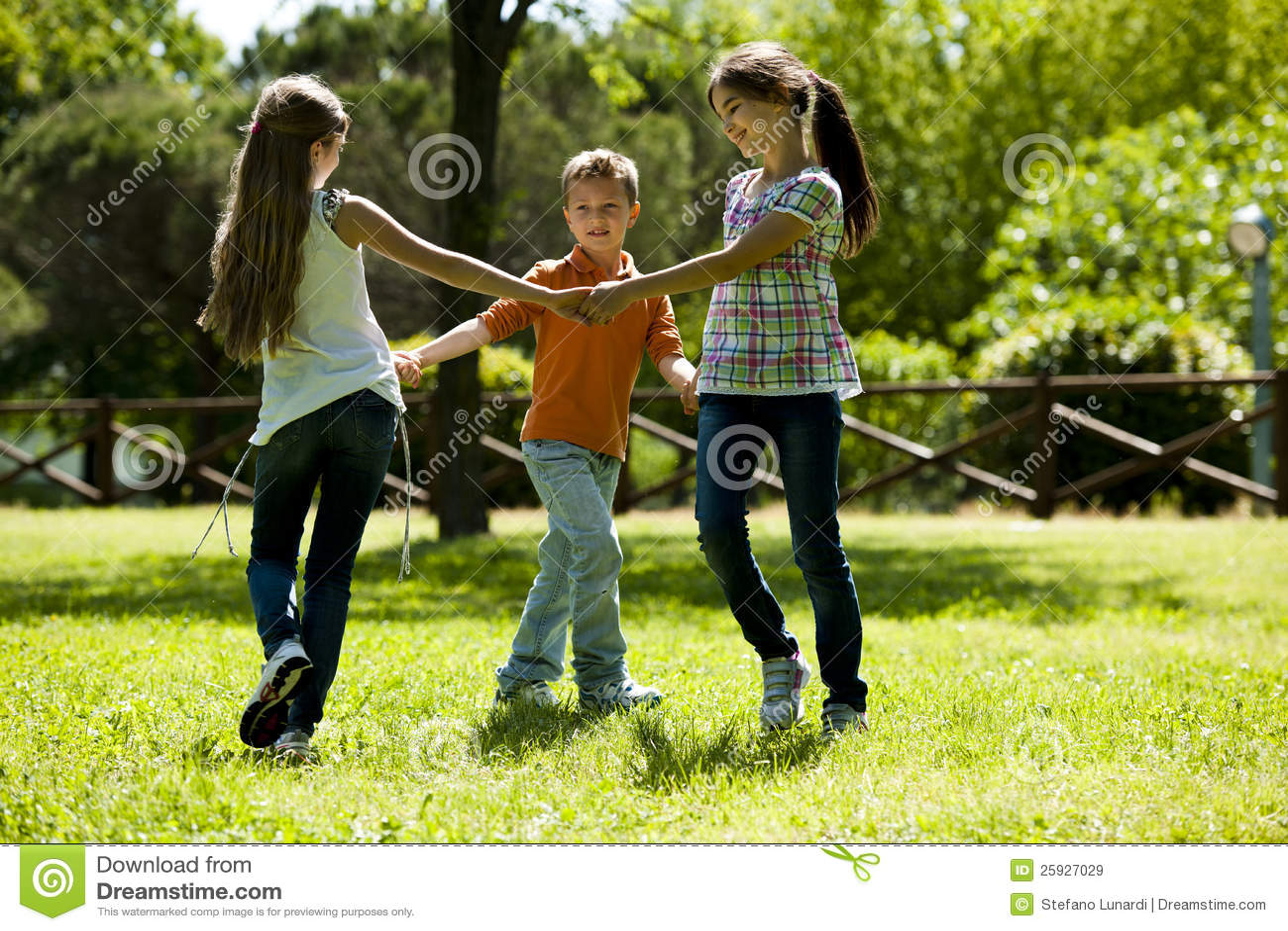 Kids Playing Ring Around The Rosey