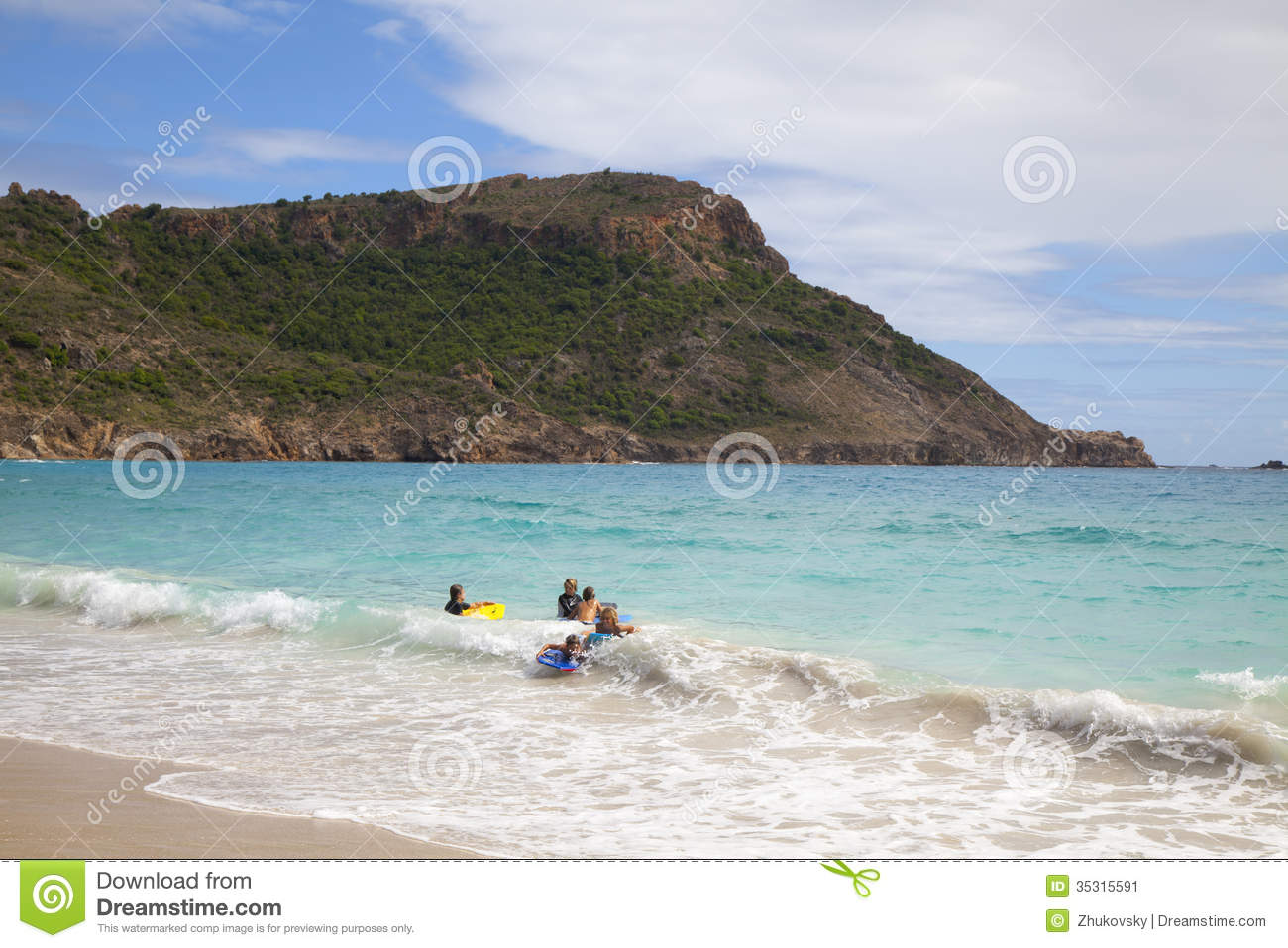Children playing at saline beach at st barths editorial for St barts tours