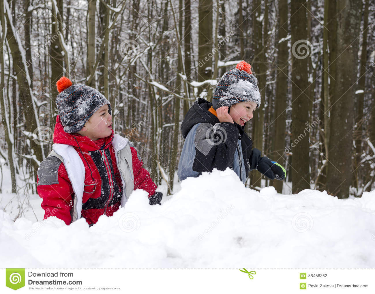 Children playing in snow in winter
