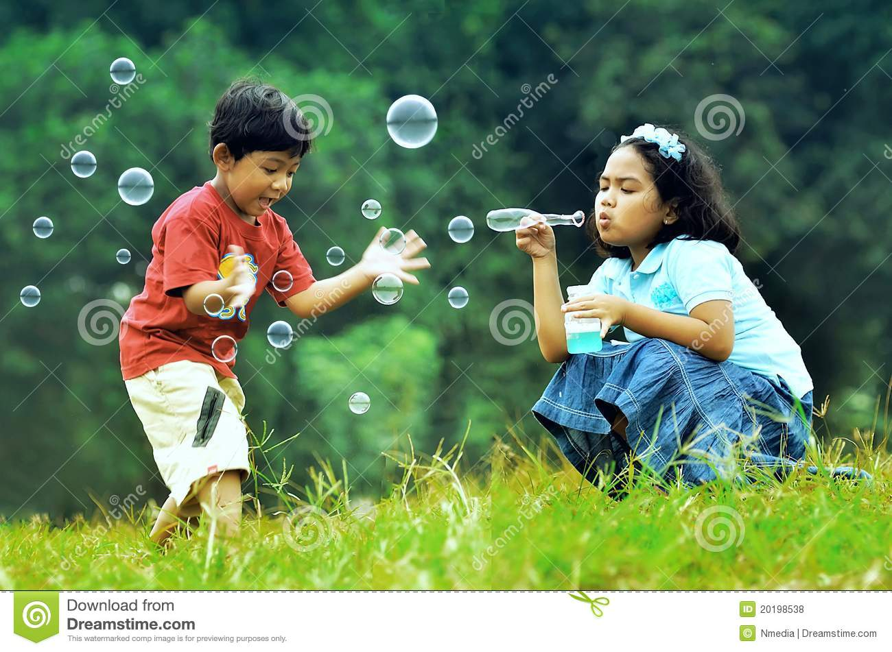 Children Playing With Soap Bubbles Royalty Free Stock