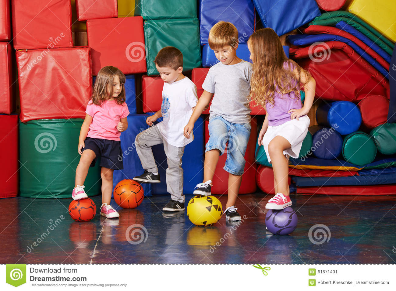 Kinder Garden: Children Playing Soccer In Gym Stock Image