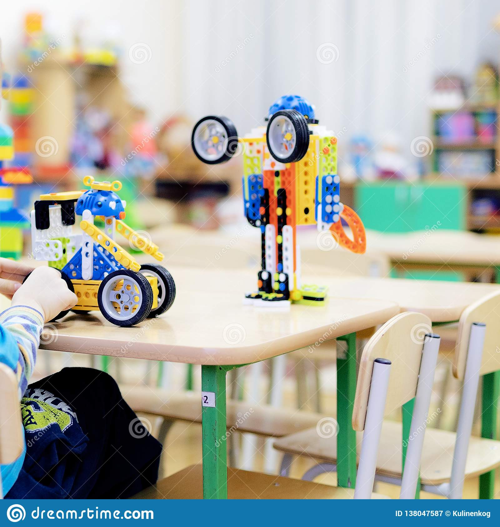 Children playing together at daycare with educational toys indoors.