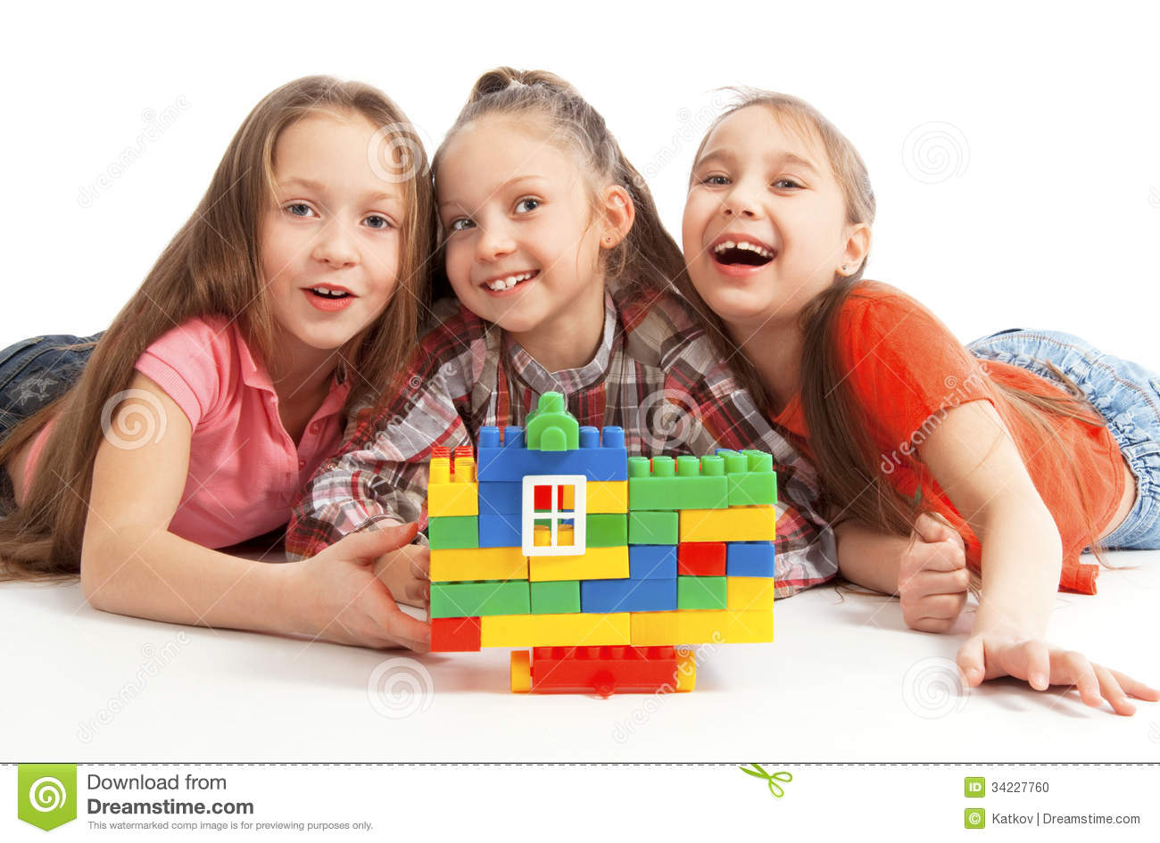 Children Playing A Toy House Stock Photo - Image: 34227760