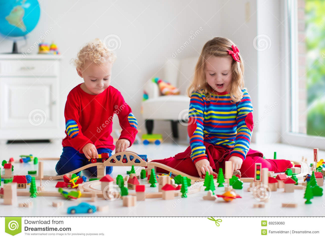Children Playing With Toy Railroad And Train Stock Photo ...