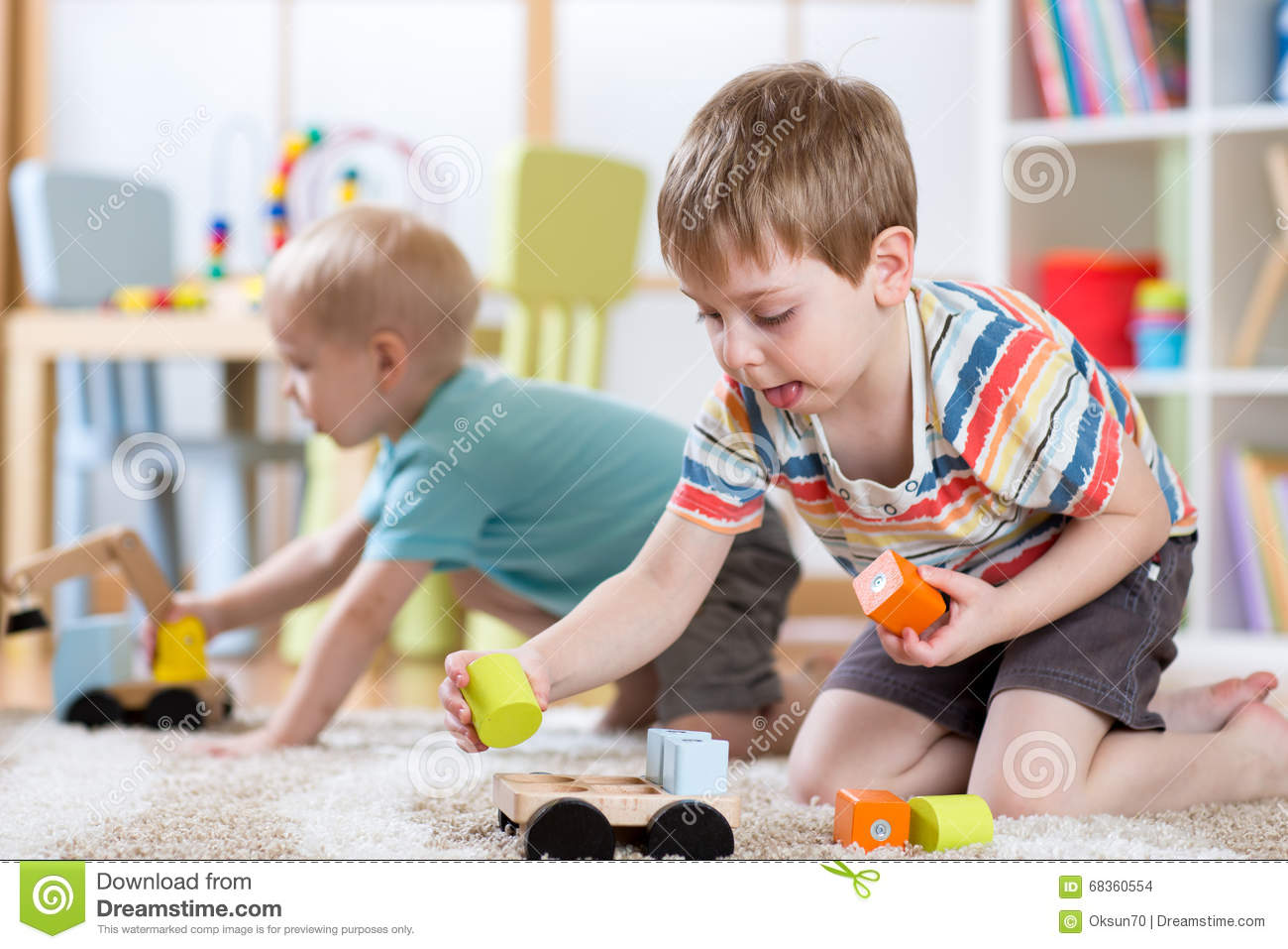 Kinder Garden: Children Playing With Toys In Kindergarten Or Daycare Or