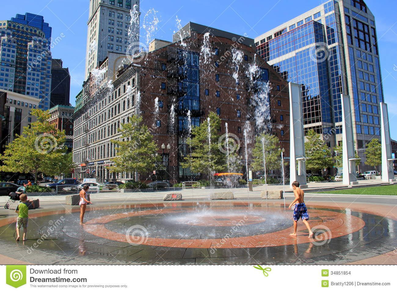 Children Playing In Water Fountain Pn Busy City Block ...