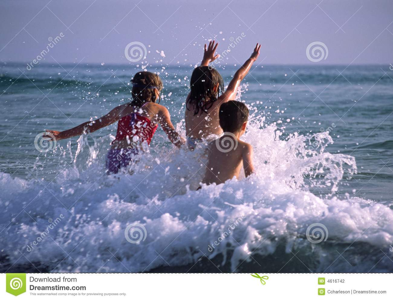 Children playing in the waves